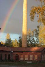 tęcza po deszczu chmury fabryka komin nieczynna kopalnia