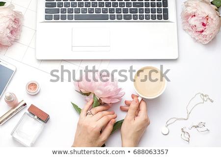 beauty-flat-lay-laptop-flowers-450w-688063357.jpg