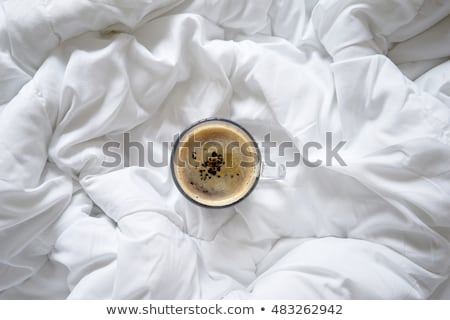 cup-coffee-on-bed-top-450w-483262942.jpg