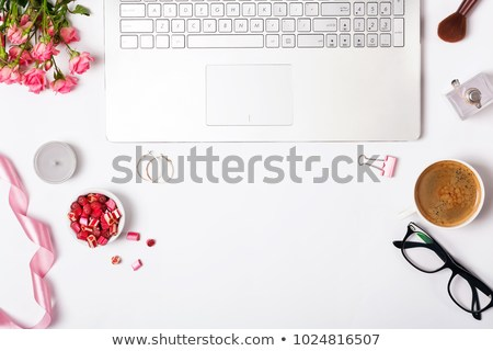 feminine-workplace-top-view-laptop-450w-1024816507.jpg