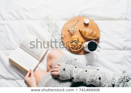 woman-sitting-bed-reading-book-450w-741469006.jpg
